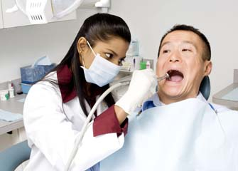 Dentist performing procedure on patient